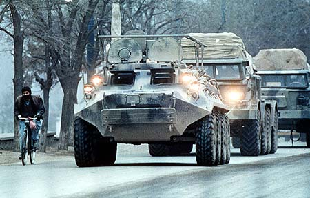 A Soviet armored vehicle leads a convoy on the streets of Kabul, Afghanistan's capital