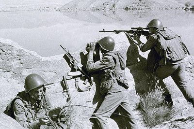 In this April 1988 photo, Soviet soldiers observe the highlands, while fighting Islamic guerrillas at an undisclosed location in Afghanistan