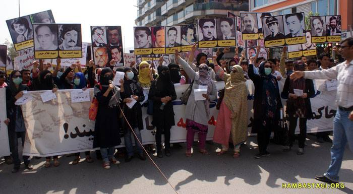 Protestors of the Solidarity Party of Afghanistan hold placards with photos of intellectuals and freedom-fighters martyred by the Soviet puppet regime