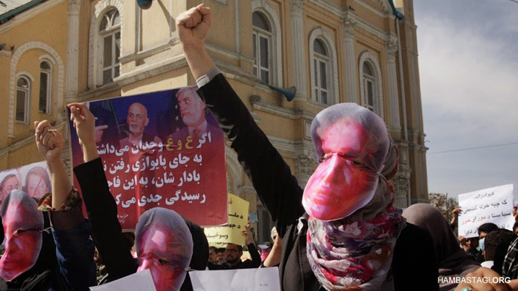 Women from the Solidarity Party of Afghanistan wore masks of Farkhunda's bloodied face, calling for justice
