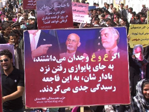 A placard held by a protestor from the Solidarity Party of Afghanistan