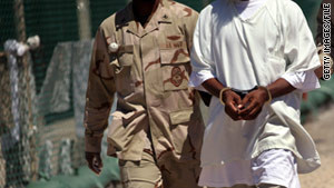 A U.S. military guard moves a detainee held at Guantanamo Bay, Cuba, in 2010