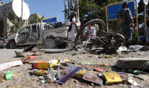 Locals inspect the site of a bomb explosion in Herat on August 15