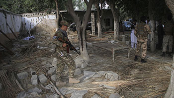 Afghan Security personnel inspect the site of a suicide attack in the Kama district of Nangarhar province, Afghanistan