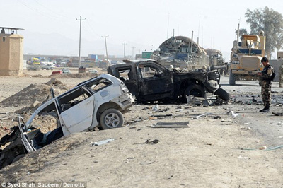 A Taliban suicide bomber detonated a car packed with explosives outside a U.S. and NATO base killing seven civilians