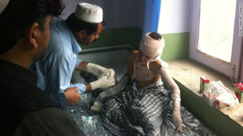 An injured student gets treatment after a suicide bomber blew himself up outside a school