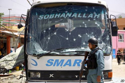 An Afghan official says a suicide bomber struck a minibus carrying government employees in Kabul