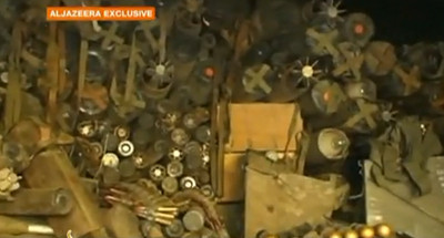 Footage showing weapons and ammunition, including mines with US markings on them.