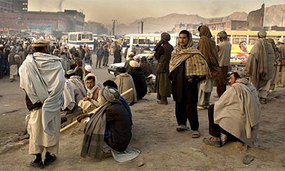 Unemployed day labourers gather in kabul in the hope of getting work