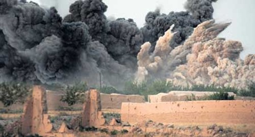 A B1-B Bomber delivered a 2,000 lb bomb upon village in Helmand