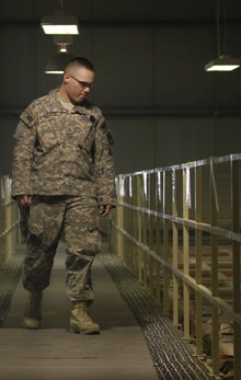 A U.S. military guard watches over detainee cells inside the Parwan detention facility