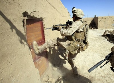 US Marine break the door of a house in Marja