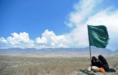 Afghan women cry on site of mass grave