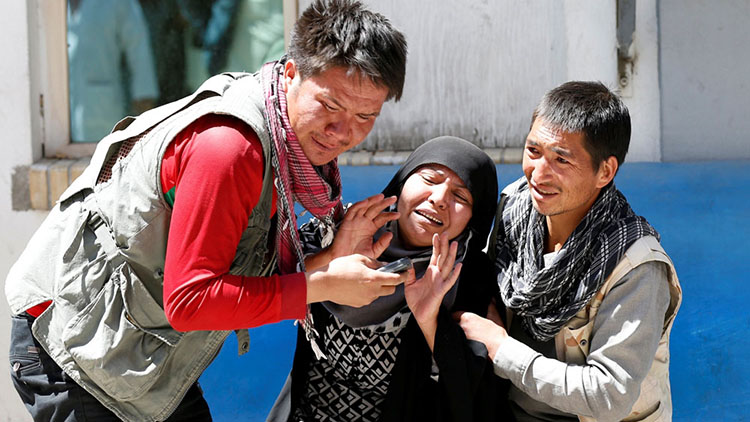 Relatives of the victims mourn at a hospital in Kabul