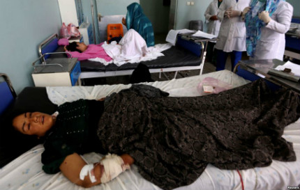 A woman who was wounded during an airstrike in Herat Province, Afghanistan, receives treatment. The airstrike occured the day before and killed at least 13 civilians