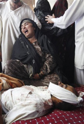 An Afghan woman mourns over the body of her son, Abdul Satar, who was allegedly killed in an Afghan-led operation in Laghman, east of Kabul
