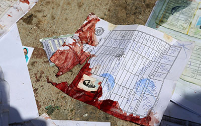 Blood-stained national ID papers of a woman following a April 22 suicide attack on a voter registration center in Kabul, Afghanistan