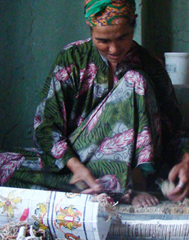 Female carpet weaver