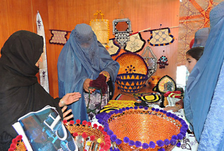 A women entrepreneur in Khost displays her products made from locally available materials