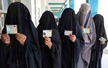 Women in a polling station