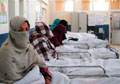 Stark choice for many Afghans: sickness or debt
