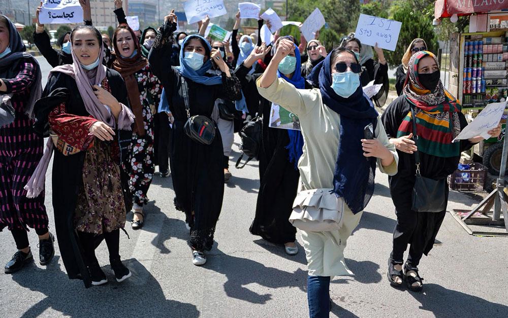 Hundreds of men and women shouting slogans