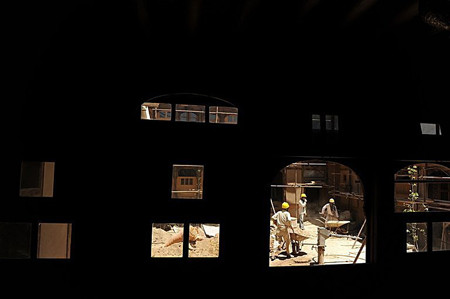 Afghan construction workers restore a traditional courtyard house in Kabul