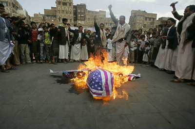Protesters loyal to the Shia al-Houthi rebel group burn an effigy of a US aircraft during a demonstration to protest against US drone strikes