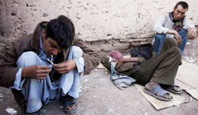 Young Afghan drug addicts smokes heroin in Herat, west of Kabul, Afghanistan