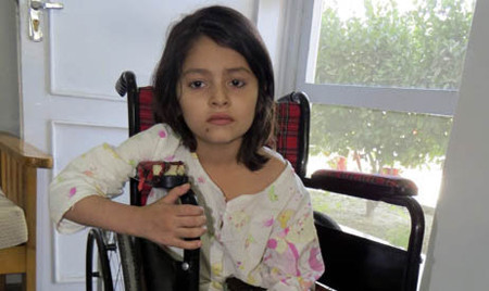 Zarsanga, 5, was hit in the hip by a bullet while playing with a 3-year-old cousin inside her home in Ghazni Province