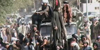 Taliban use cranes to hang two men in public